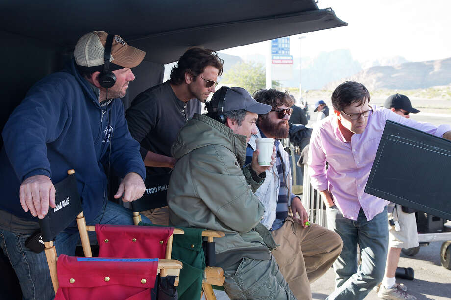 "(L-r) DP Lawrence Sher, Bradley Cooper, director Todd Phililps, Zach Galifianakis, and Ed Helms on the set of ""The Hangover III."" Photo: Melinda Sue Gordon, Warner Brothers / © 2013 WARNER BROS. ENTERTAINMENT INC. AND LEGENDARY PICTURES"