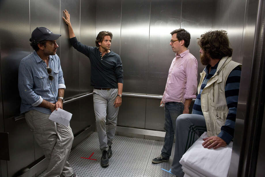 "(L-r) Director Todd Phillips, Bradley Cooper, Ed Helms, and Zach Galifianakis on the set of ""The Hangover III."" Photo: Melinda Sue Gordon, Warner Brothers / © 2013 WARNER BROS. ENTERTAINMENT INC. AND LEGENDARY PICTURES"