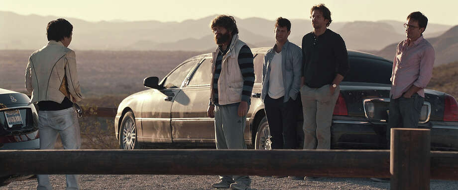 "Ken Jeong as Mr. Chow, Zach Galifianakis as Alan, Justin Bartha as Doug, Bradley Cooper as Phil and Ed Helms as Stu in ""The Hangover III."" Photo: Courtesy Warner Bros. Pictures, Warner Brothers / © 2013 WARNER BROS. ENTERTAINMENT INC. AND LEGENDARY PICTURES"
