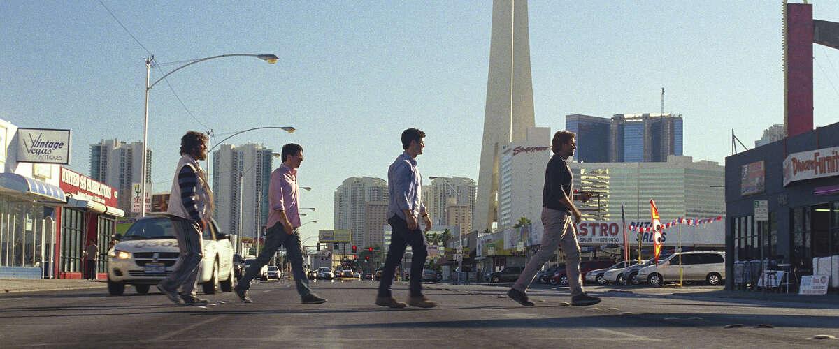 Zach Galifianakis as Alan, Ed Helms as Stu, Justin Bartha as Doug and Bradley Cooper as Phil in