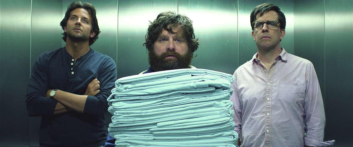 Bradley Cooper as Phil, Zach Galifianakis as Alan and Ed Helms as Stu in