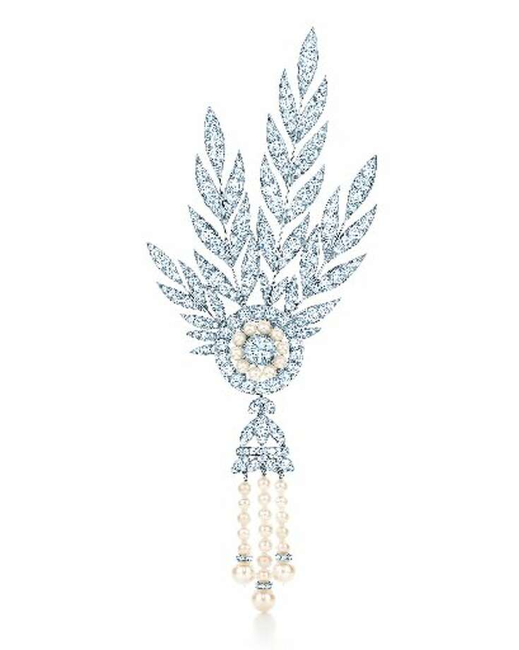 The Savoy, a diamond and freshwater cultured pearl headpiece with detachable brooch, inspired by a Native American design in the Tiffany Archives. From The Great Gatsby collection by Tiffany & Co., inspired by Baz Luhrmann s film in collaboration with Catherine Martin, featured in the 2013 Blue Book. $200,000