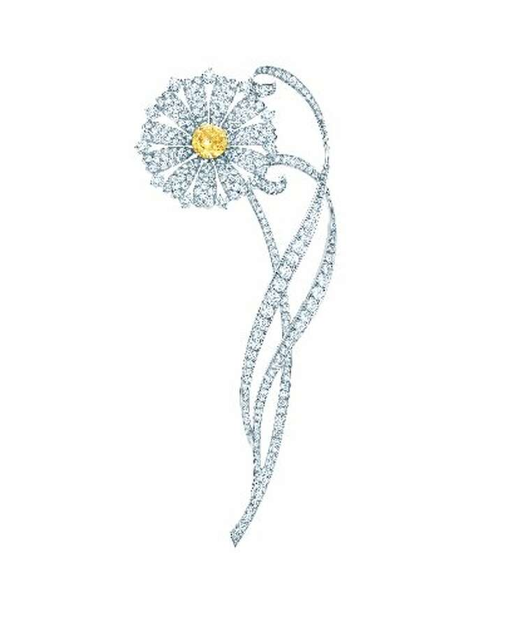 Daisy brooch of white diamonds and a fancy intense Tiffany Yellow Diamond and platinum. From The Great Gatsby collection by Tiffany & Co., inspired by Baz Luhrmann s film in collaboration with Catherine Martin. $50,000