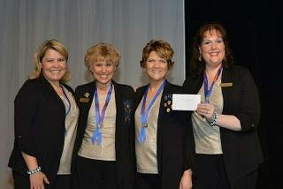 From left: Leigh Anne Dorman, Nancy Faddegon, Jennifer Hunter and Kimberly Higdon, members of the Capital Region women's acappella quartet, One Track Mind, took top honors at the Sweet Adelines Region 16 competition in Syracuse. (Jennifer Hunter)
