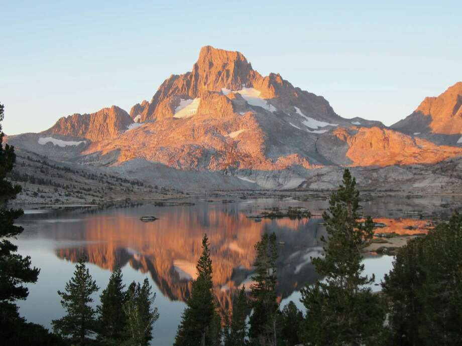 This Sept. 25, 2012 photo shows Banner Peak in the Ansel Adams Wilderness in Yosemite National Park in California. Yosemite is one of the most visited parks in the national park system, but a hiking trip to the backcountry can offer access to uncrowded, pristine areas. (AP Photo/John Pain) Photo: John Pain