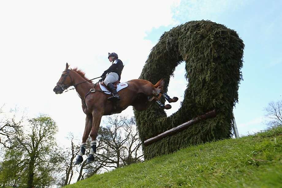Of all the obstacles of the Cross Country Test of the Badminton Horse Trials in Badminton, Gloucestershire, none is feared more than the giant green doughnut. Photo: Michael Steele, Getty Images