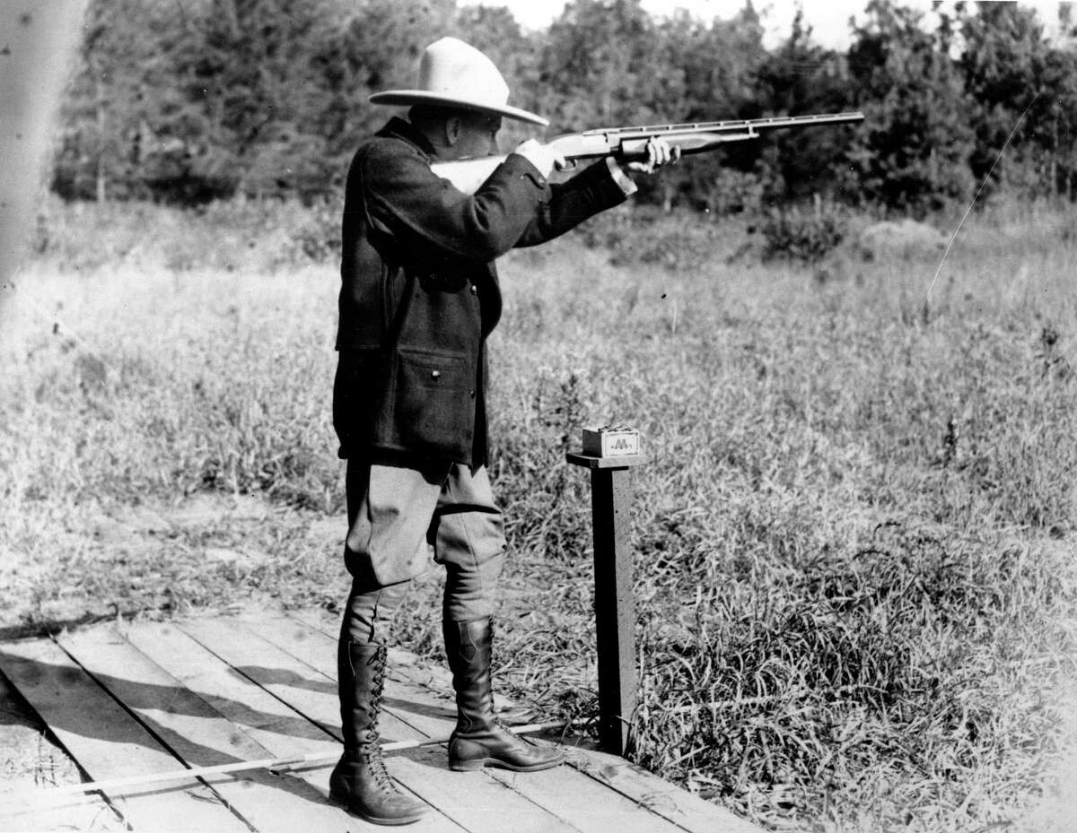 In this Sept. 6, 1928 file photo, U.S. President Calvin Coolidge shoots at clay pigeons at his vacation home on the Brule at Superior, Wis., He scored 29 out of 37. (AP Photo/File)