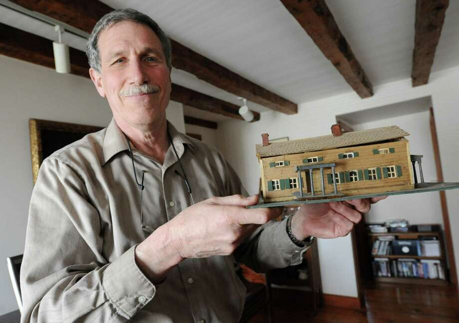 Architect Robert Mitchell stands inside his home and holds a model of the 1804 farmhouse he restored into his house on Wednesday, April 17, 2013 in New Scotland, N.Y.  (Lori Van Buren / Times Union) Photo: Lori Van Buren
