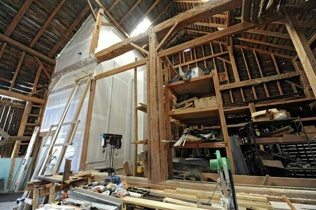 Inside Architect Robert Mitchell's converted 19th-century barn he restored to house his architect offices that is on the property next to the 1804 farmhouse he restored on Wednesday, April 17, 2013 in New Scotland, N.Y. The door on the left is one of the doors that leads into the restored office part of the barn.  (Lori Van Buren / Times Union) Photo: Lori Van Buren