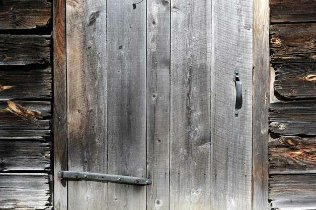 Barn door on one of the barns on Architect Robert Mitchell's property on Wednesday, April 17, 2013 in New Scotland, N.Y. Mitchell converted a 19th-century barn he restored to house his architect offices that is on the property next to the 1804 farmhouse he restored. (Lori Van Buren / Times Union) Photo: Lori Van Buren