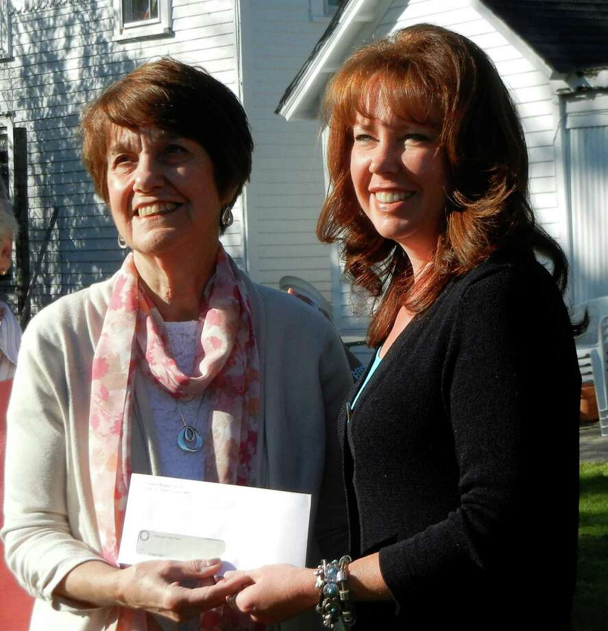 Rose Jordan, chairwoman of the Reugg Grant Committee, left, presents the Ruegg Grant Award check to Elizabeth Beller, board chairwoman of Wakeman Town Farm. Photo: Contributed Photo