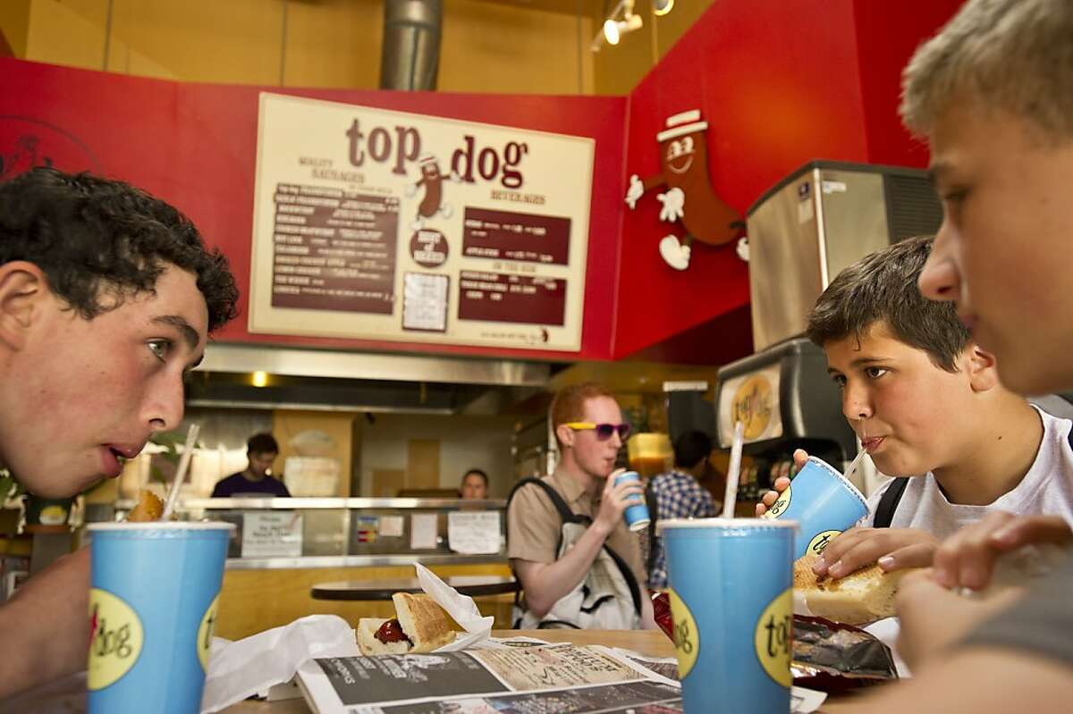 Cyrus Stenstedt, right, a freshman at Berkeley High School, drinks soda while lunching off-campus at Top Dog on Tuesday, April 30, 2013, in Berkeley, Calif.