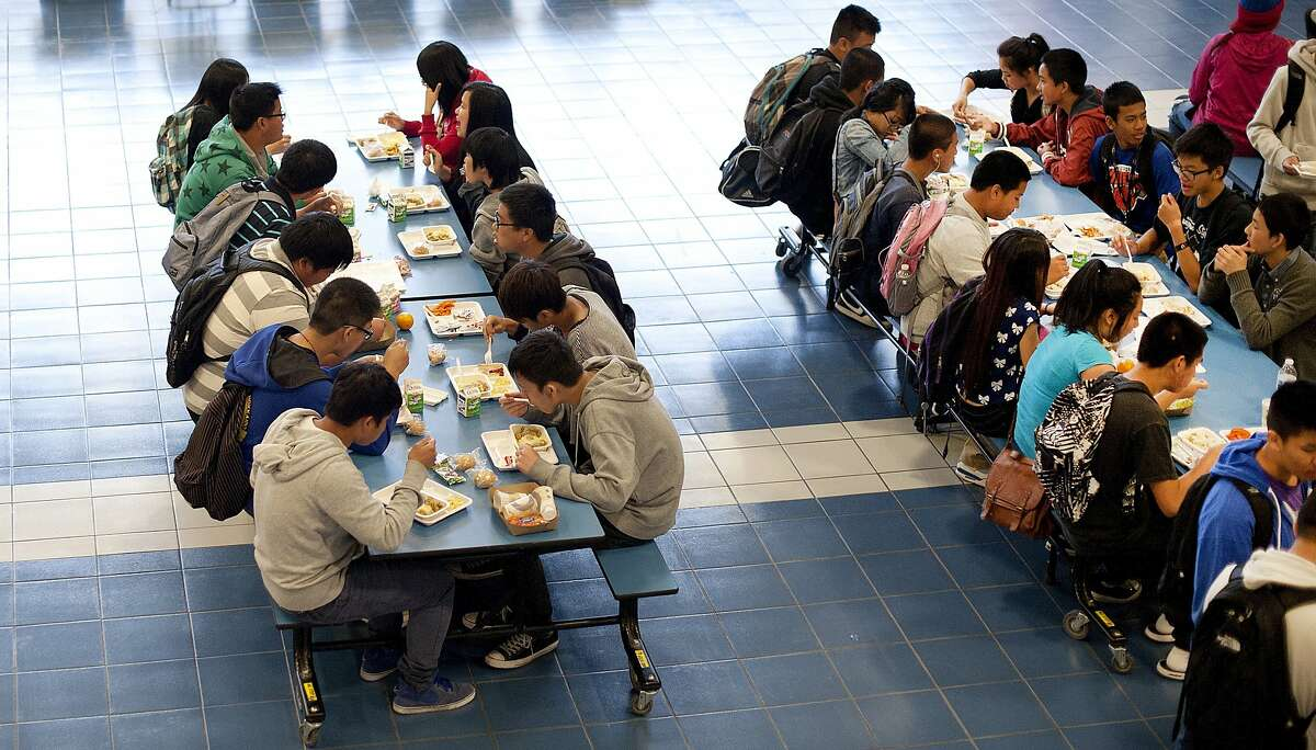 Students eat lunch at Oakland High School on Friday, April 26, 2013, in Oakland, Calif.