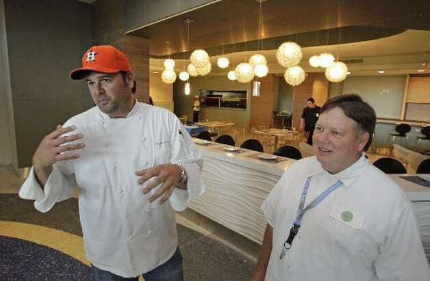 Bryan Caswell and Bill FloydPhoto:Bill Floyd, right, and chef Bryan Caswell