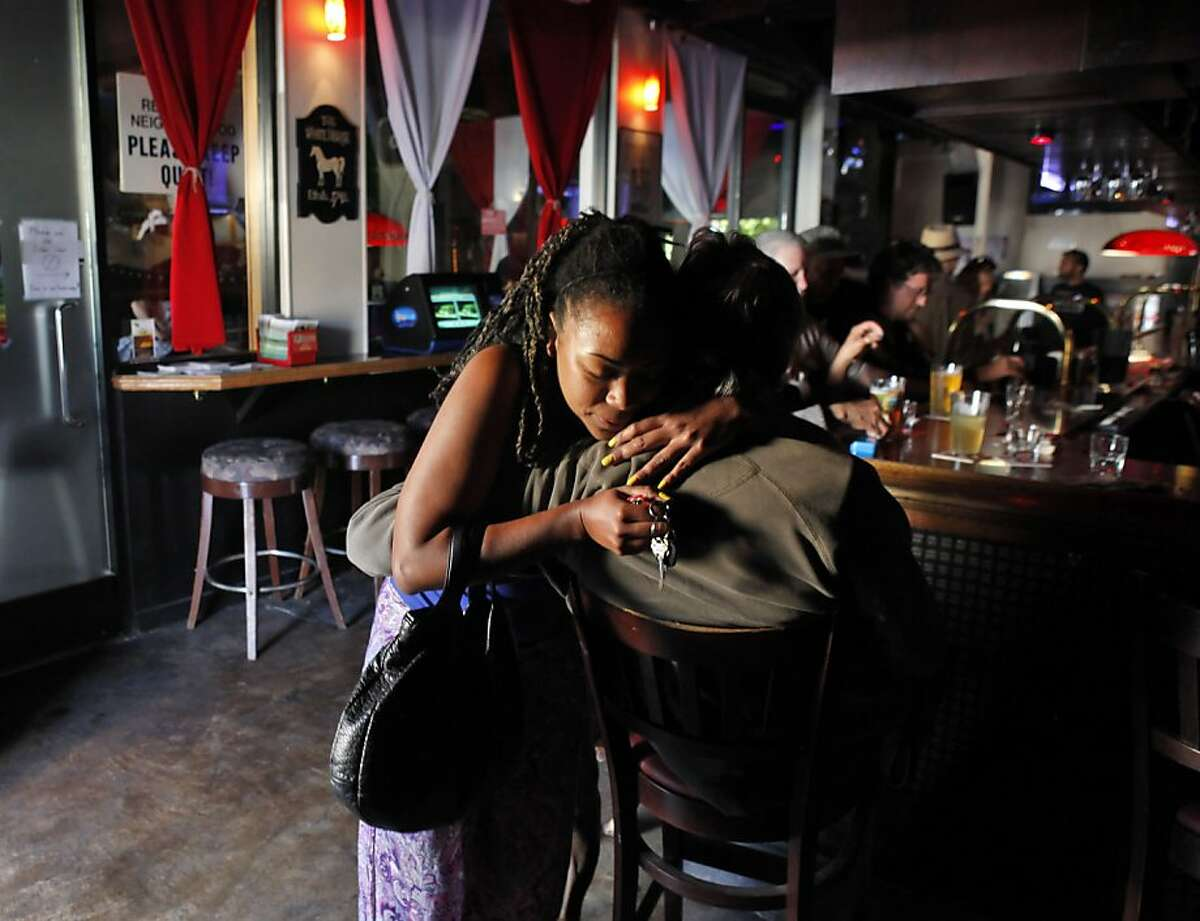 Danielle Anderson hugs another bar patron (who declined to be identified) at the White Horse Tavern in Oakland, Calif., on Tuesday, May 7, 2013. The bar is thought to be the oldest gay bar in the country and turns 80 this week. Some of the regulars have been frequenting the bar since the 40s.