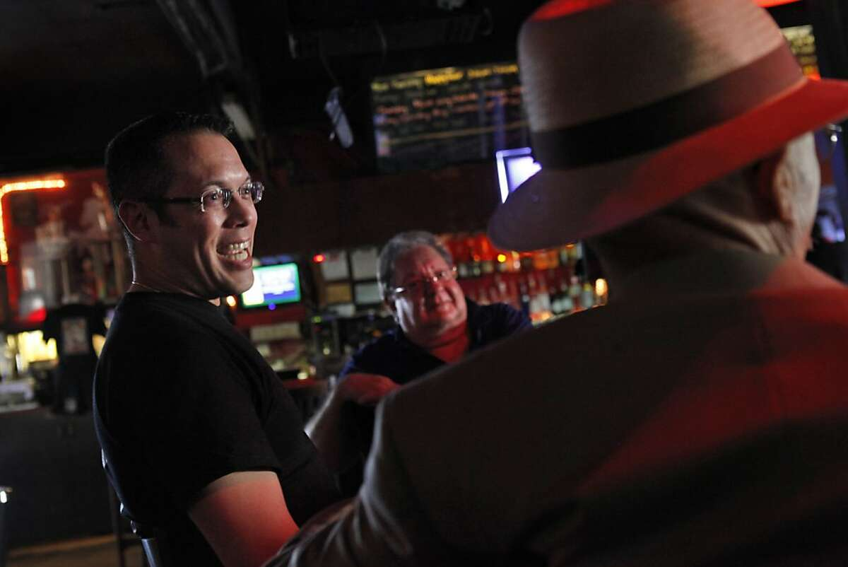 Joe Velez, the general manager of the White Horse Tavern, left, speaks with bar owner Chuck Davis, center, and patron Patrick O'Leary, right, on Tuesday, May 7, 2013. The White Horse tavern in Oakland, Calif., is thought to be the oldest gay bar in the country and turns 80 this week. Some of the regulars have been frequenting the bar since the 40s.