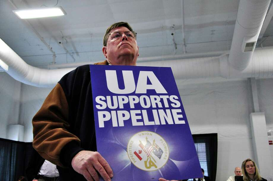 A union member attends a public hearing on the Keystone Pipeline on April 18, 2013 in Grand Island, Nebraska. Supporters and opponents of the extension of the Keystone Pipeline, which could carry oil from Canada to the Gulf of Mexico, have publicly clashed in Nebraska, where the project is very controversial because of its potential impact on the environment.  AFP PHOTO/Guillaume MeyerGuillaume Meyer/AFP/Getty Images Photo: GUILLAUME MEYER, Staff / AFP