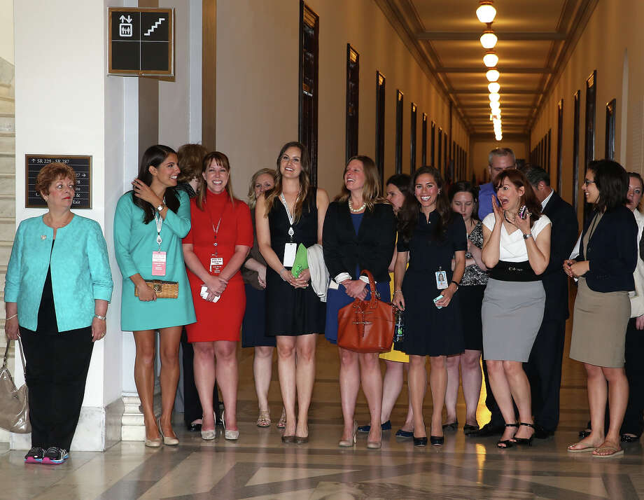 Women await the arrival of HRH Prince Harry before he tours an anti-landmine photography exhibition by The HALO Trust charity during the first day of his visit to the United States at the Russell Senate Office Building on May 9, 2013 in Washington, DC. HRH will be undertaking engagements on behalf of charities with which the Prince is closely associated on behalf also of HM Government, with a central theme of supporting injured service personnel from the UK and US forces. Photo: Chris Jackson, Getty Images / 2013 Getty Images