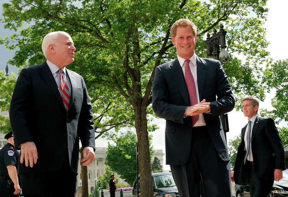Prince Harry greets U.S. Sen. John McCain (L) (R-AZ) while arriving on Capitol Hill during the first day of his visit to the United States at Russell Senate Office Building on May 9, 2013 in Washington, DC. HRH will be undertaking engagements on behalf of charities with which the Prince is closely associated on behalf also of HM Government, with a central theme of supporting injured service personnel from the UK and US forces. Photo: Win McNamee, Getty Images / 2013 Getty Images