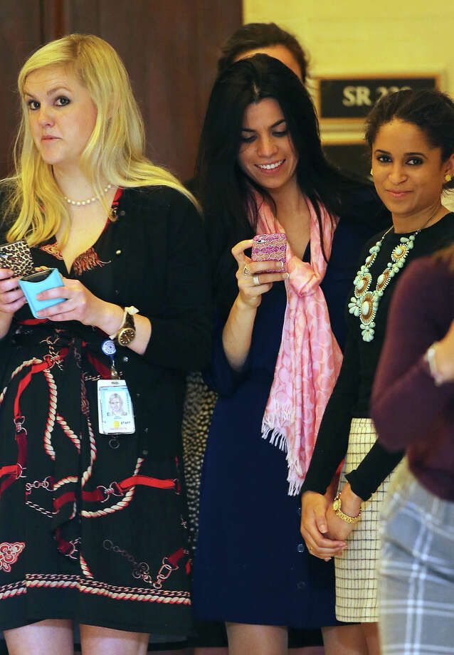 Women watch and take camera phone pictures as HRH Prince Harry tours an anti-landmine photography exhibition by The HALO Trust charity during the first day of his visit to the United States at the Russell Senate Office Building on May 9, 2013 in Washington, DC. HRH will be undertaking engagements on behalf of charities with which the Prince is closely associated on behalf also of HM Government, with a central theme of supporting injured service personnel from the UK and US forces. Photo: Chris Jackson, Getty Images / 2013 Getty Images