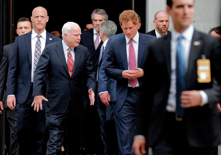 Prince Harry departs the Russell Senate Office Building with U.S. Sen. John McCain (R-AZ) during the first day of his visit to the United States May 9, 2013 in Washington, DC. HRH will be undertaking engagements on behalf of charities with which the Prince is closely associated on behalf also of HM Government, with a central theme of supporting injured service personnel from the UK and US forces. Photo: Win McNamee, Getty Images / 2013 Getty Images