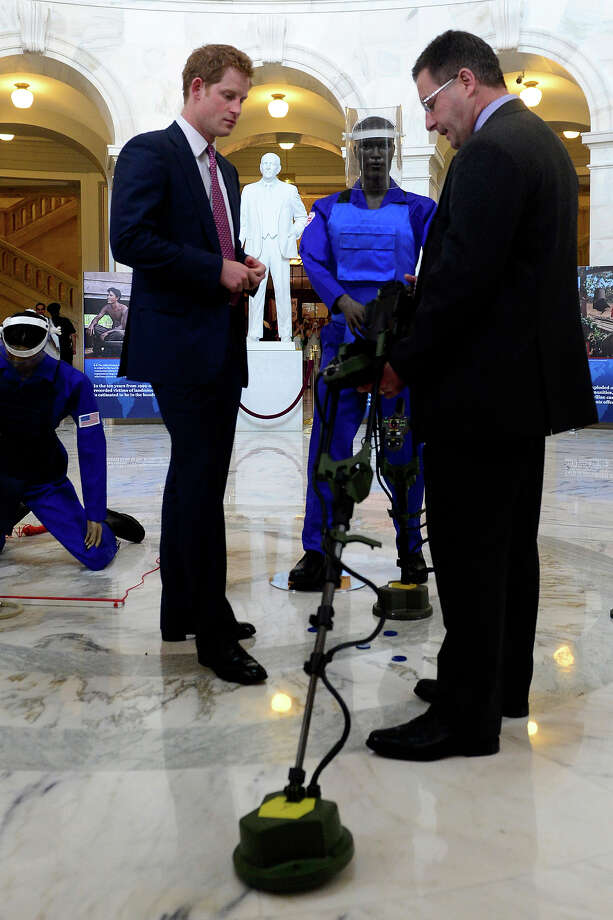 Prince Harry (L) is shown a ground penetrating radar, a tool used for detecting land mines, by HALO Trust Weapons and Ammunition Disposal Desk Officer Richard Boulter (R), during a tour of a HALO Trust photo exhibit on landmines and unexploded ordinances on May 9, 2013 in Washington, DC. HRH will be undertaking engagements on behalf of charities with which the Prince is closely associated on behalf also of HM Government, with a central theme of supporting injured service personnel from the UK and US forces. Photo: Pool, Getty Images / 2013 Getty Images