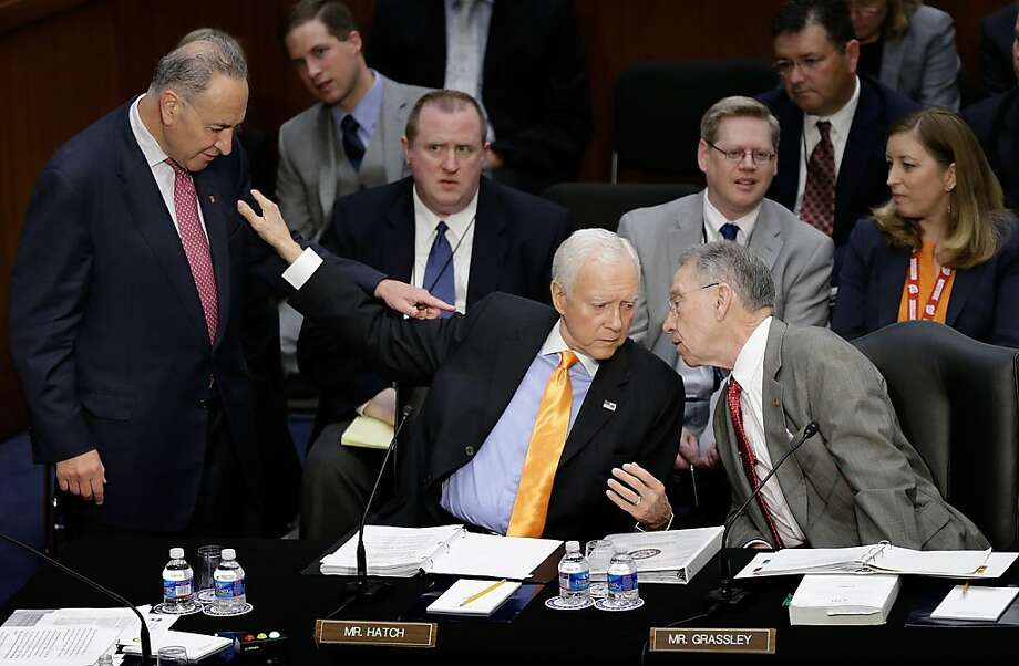 Sen. Orrin Hatch (R-UT) (C) confers with Sen. Chuck Grassley (R-IA) (R) and Sen. Chuck Schumer (D-NY) (L) during the Senate Judiciary Committee's markup for the immigration reform bill on Capitol Hill May 9, 2013 in Washington, DC. The 18 members of the committee have proposed in excess of 300 amendments to the 844 page piece of legislation that would, if passed, create a path to U.S. citizenship for undocumented immigrants.  Photo: Win McNamee, Getty Images