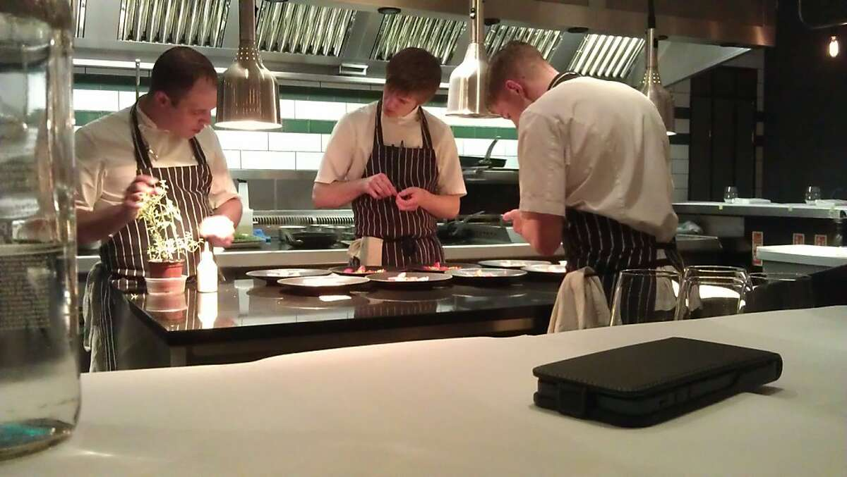 Chefs in the kitchen at the restaurant Kitchen Table in London.