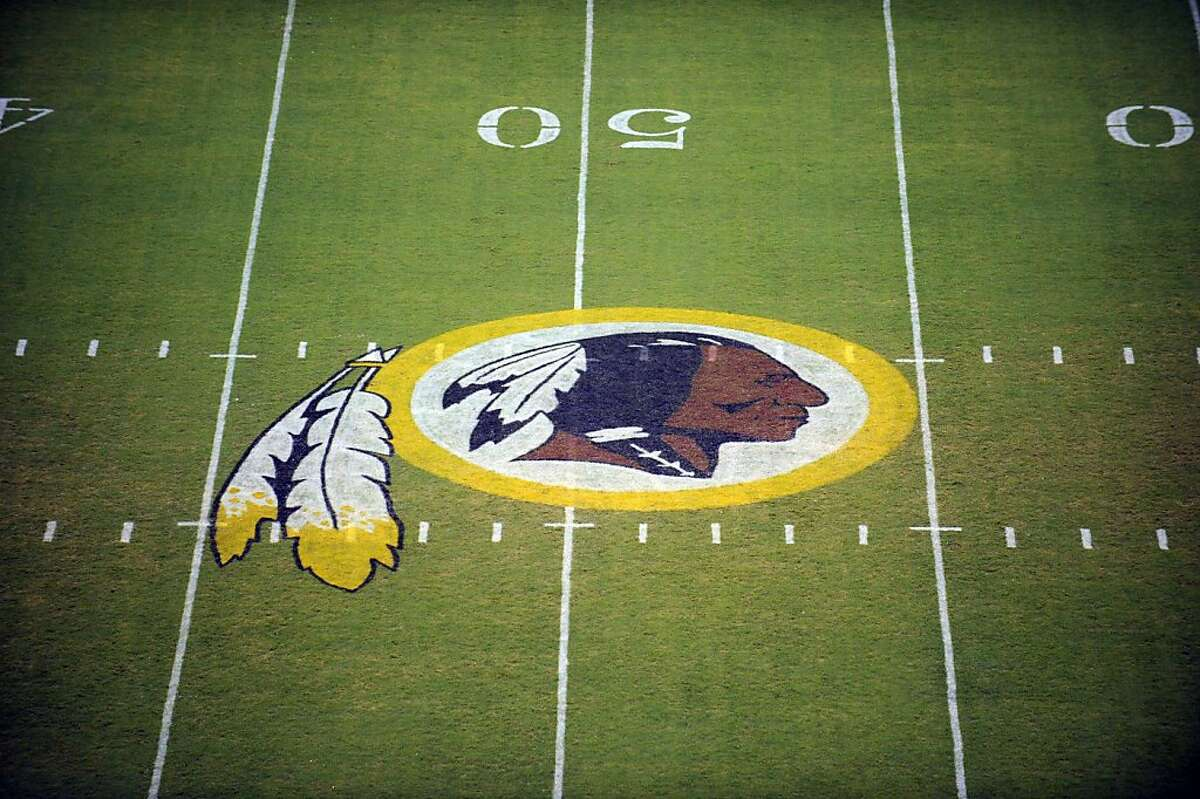 FILE - In this Aug. 28, 2009, file photo, the Washington Redskins logo is displayed at midfield before the start of a preseason NFL football game in Landover, Md. The team's nickname, which some consider a derogatory term for Native Americans, has faced a barrage of criticism. But a new Associated Press-GfK poll shows that nationally,