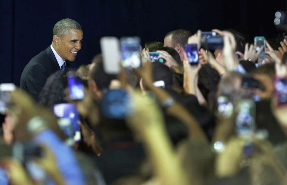President Barack Obama smiles for a sea of cell phone cameras, greeting students as he makes his way in the gym of Manor New Tech High School in Manor, TX on Thursday May 9, 2013.
