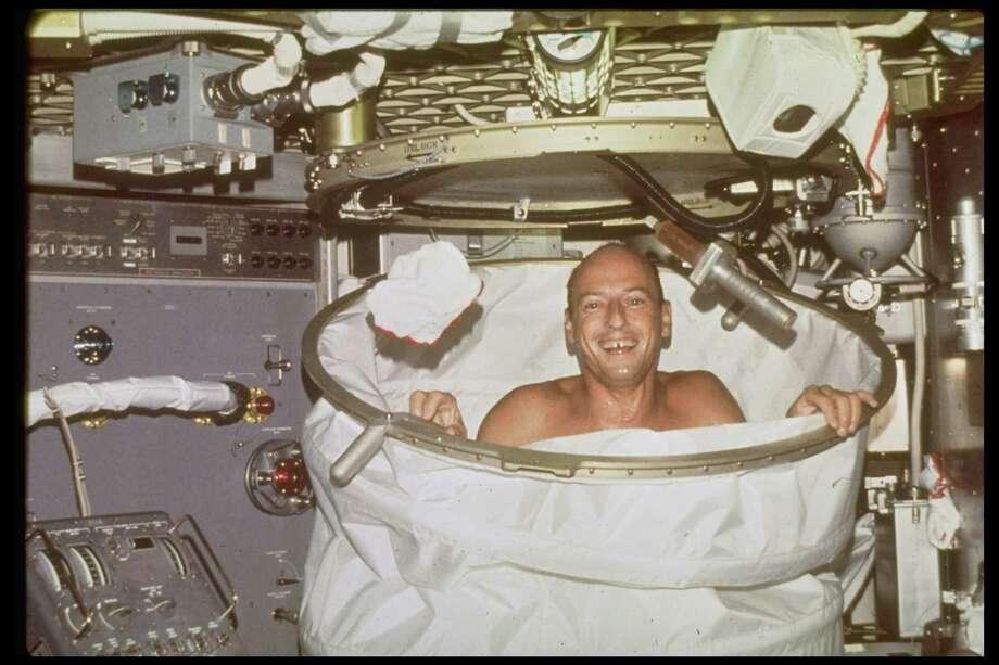 "Here, astronaut Charles ""Pete"" Conrad grins from Skylab's collapsible shower stall as a washcloth floats above his right hand during the first crewed Skylab mission. Photo: NASA, Time & Life Pictures/Getty Image / Time & Life Pictures"
