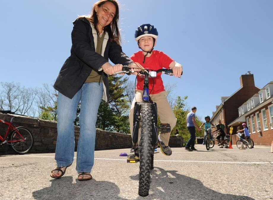 No: 21 Greenwichhas 43.3 percent of new moms in the labor force, a percent that puts the town below the state with the smallest percentage: Utah, where 49.1 percent of new moms were in the labor force.  Kevin Toepelt, 7, of Greenwich, gets a little balancing help from his mom, Dawn, during the Bicycle Rodeo at the Julian Curtiss School in Greenwich, Saturday, May 4, 2013. The event, held  as part of National Bike Month to promote bicycle safety and the health benefits of biking, was sponsored by the Julian Curtiss School P.T.A, the YMCA of Greenwich, Greenwich Safe Cycling, and the Greenwich Police Silver Shield Association. Jamie Cahill of the Julian Curtiss School P.T.A. said more than sixty children attended the event.