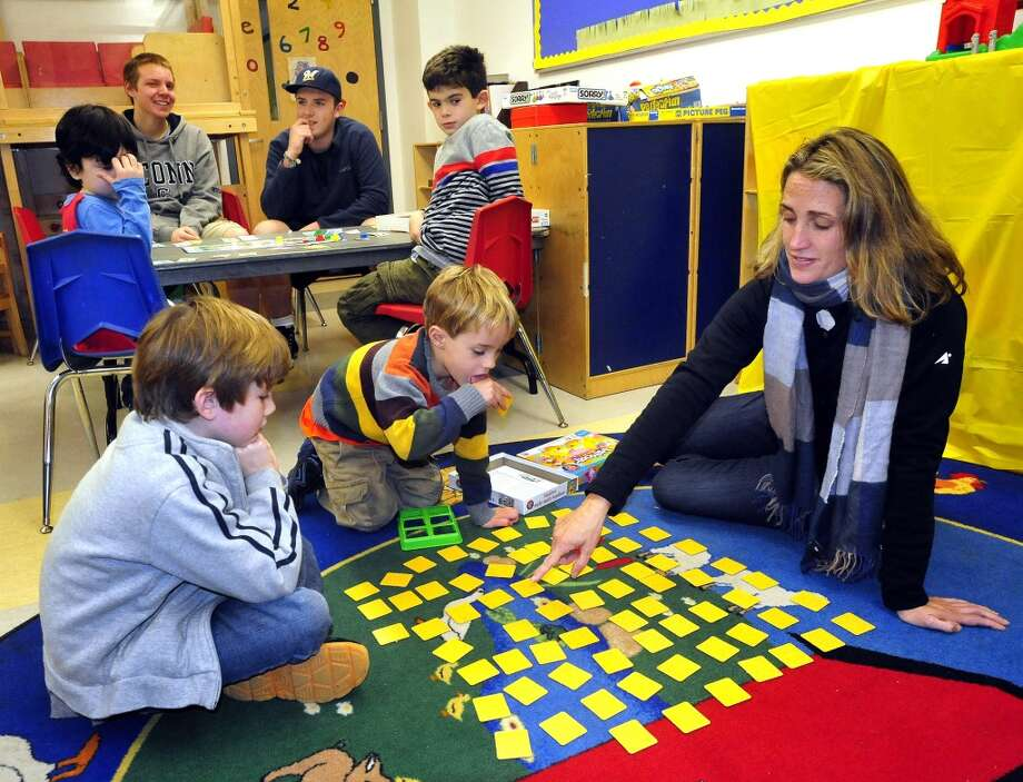 No: 16 Ridgefield has 56.5 percent of new moms in the labor force. The national average is 60.8 percent.  Shane Taylor, 7, left, his brother, Ryan, 5, and mom, Charis, pass time with games in the Ridgefield Town Emergency shelter at the Ridgefield Parks & Recreation Center Thursday, Nov. 1, 2012.