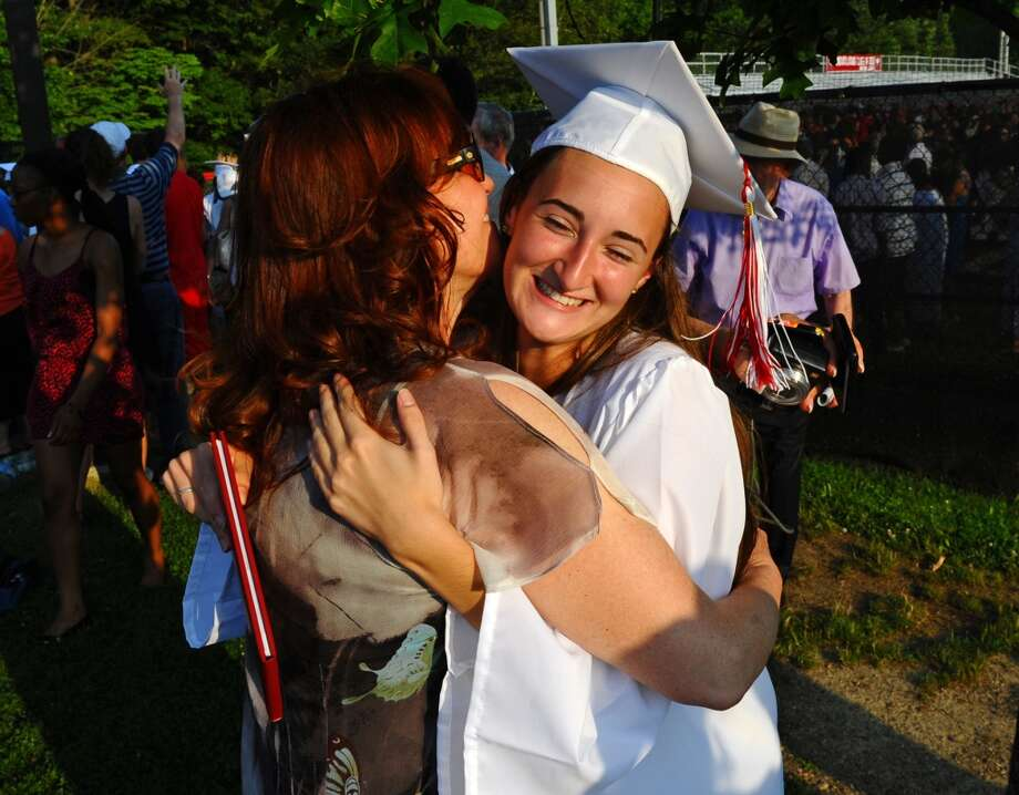 No: 15 New Canaan has 57.3 percent of new moms in the labor force. The national average is 60.8 percent.  Graduate Olivia Bochicchio gets a hug from her mom Leigh, after New Canaan High School's Class of 2012 Graduation Ceremony in New Canaan, Conn. on Wednesday June 20, 2012.