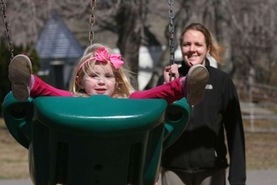 No: 14 Shelton has 58.5 percent of new moms in the labor force. The national average is 60.8 percent.  Michaela Cronin, 4 of Shelton, and her mom, Mary Ann,  swing at Boothe Memorial Park in Stratford on Sunday, March 27, 2011.