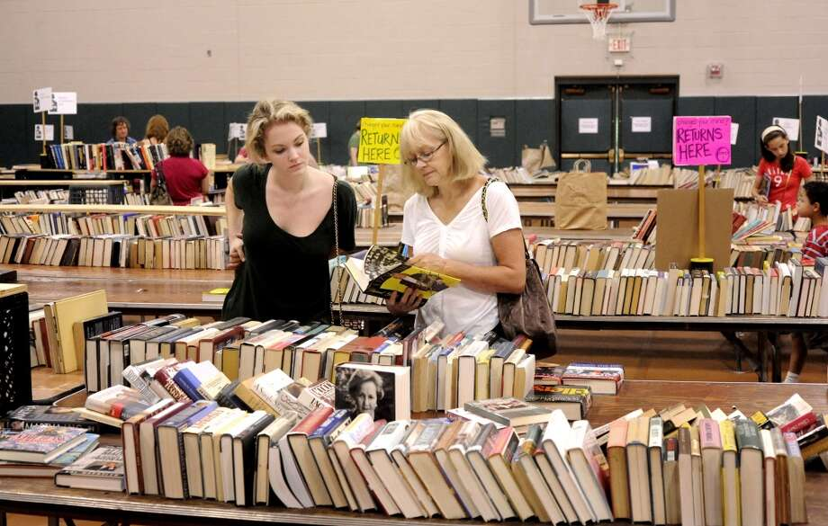 No: 11 Wilton has 67.8 percent of new moms in the labor force. The national average is 60.8 percent.  Avery Sorrels, left, and her mom, Avery, of Wilton, browse through books during the 51st Annual Book Fair sponsored by the Mark Twain Library at the Redding Community Center Monday, Sept. 5, 2011.