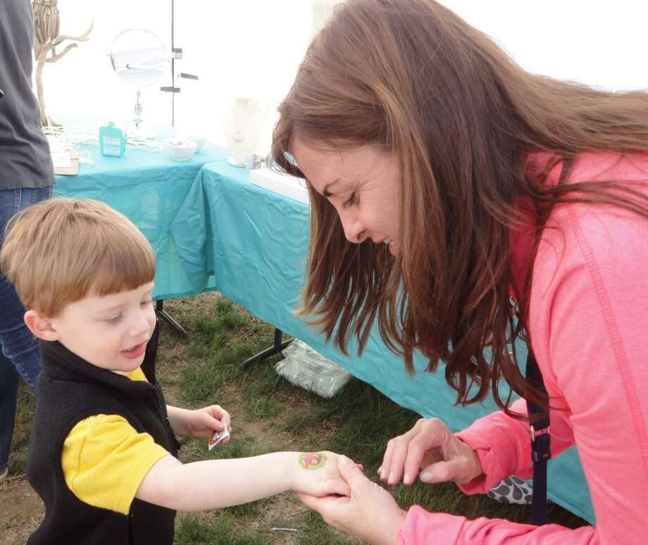 No: 7 Fairfield has 71.5 percent of new moms in the labor force. The national average is 60.8 percent.  Max Goldman, 3, of Fairfield, shows off his owl temporary tatoo to his mom Lisa at the 78th annual Dogwood Festival.