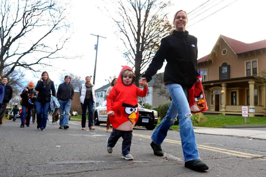 No: 6 Bridgeport has 72.2 percent of new moms in the labor force. The national average is 60.8 percent.  Max Eastman, 4, is dressed up an an Angry Bird as he walks in the parade with his mom Tricia, during the Fourth Annual Black Rock Halloween Parade and Block Party which started at Ellsworth Field and ended at the Black Rock Branch Library for snacks in the Black Rock section of Bridgeport, Conn. on Friday November 2, 2012. The event was organized by the library and the Black Rock chapter of the Rotary Club.
