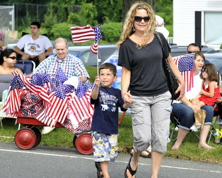 No: 5 New Fairfield has 73 percent of new moms in the labor force. The national average is 60.8 percent.  Joseph Comizio, 6, and his mom, Gordana, visit the Fourth of July Parade, sponsored by the New Fairfield Lions Club, that is held Monday, July 4, 2011.