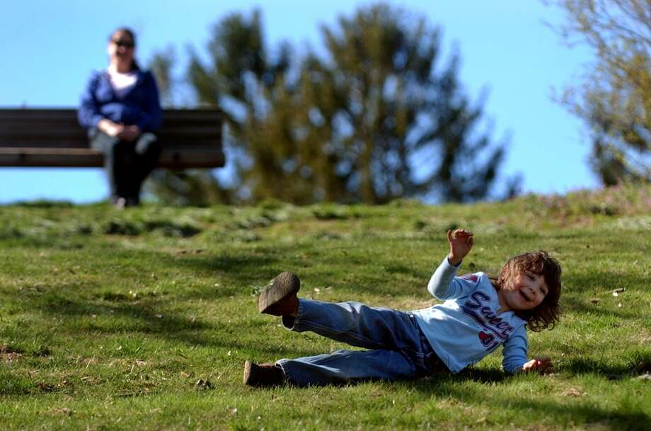 No: 4 Stratford has 73 percent of new moms in the labor force. The national average is 60.8 percent.  Ashley McGhee, 4, of Stratford, has fun rolling down the hill as her mom Michele look on at Boothe Memorial Park in Stratford, Conn. on Saturday April 7, 2012.