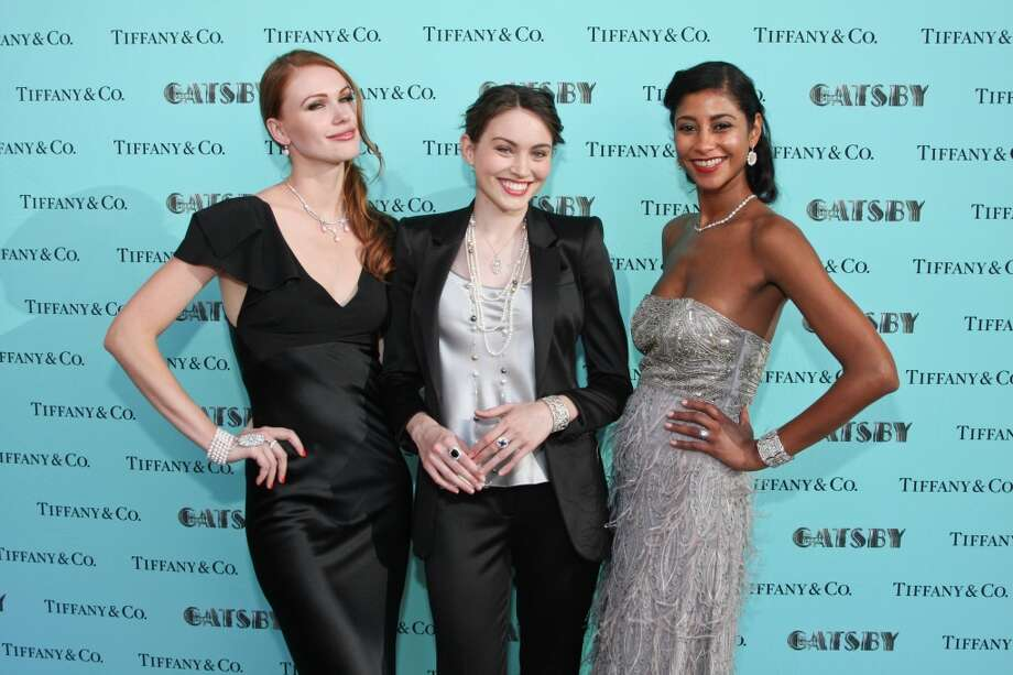 Models pose at the step and repeat donning pieces from Tiffany & Co.