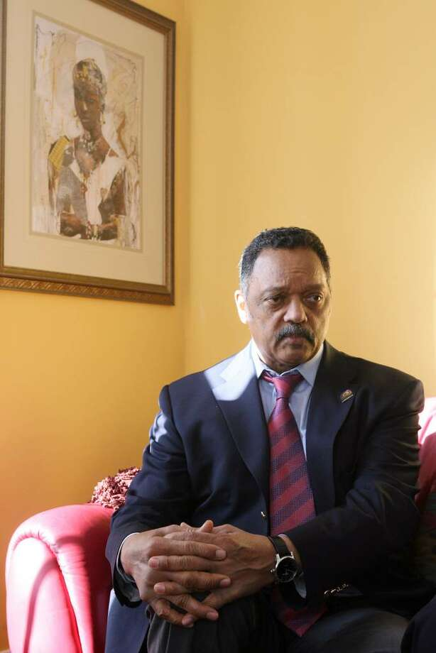 Reverend Jesse Jackson sits in  the home of Pastor Robert Turner and vows to help him fight the foreclosure of his Bridgeport home. Turner is pastor at the Bridgeport Bible Fellowship Church. Jackson also addressed members of the Interdenominational Ministries Alliance at Russel Temple CME Church on Saturday, Jan. 9, 2010.  He addressed the problems of foreclosures, credit card debt, and school loans. Photo: B.K. Angeletti / Connecticut Post