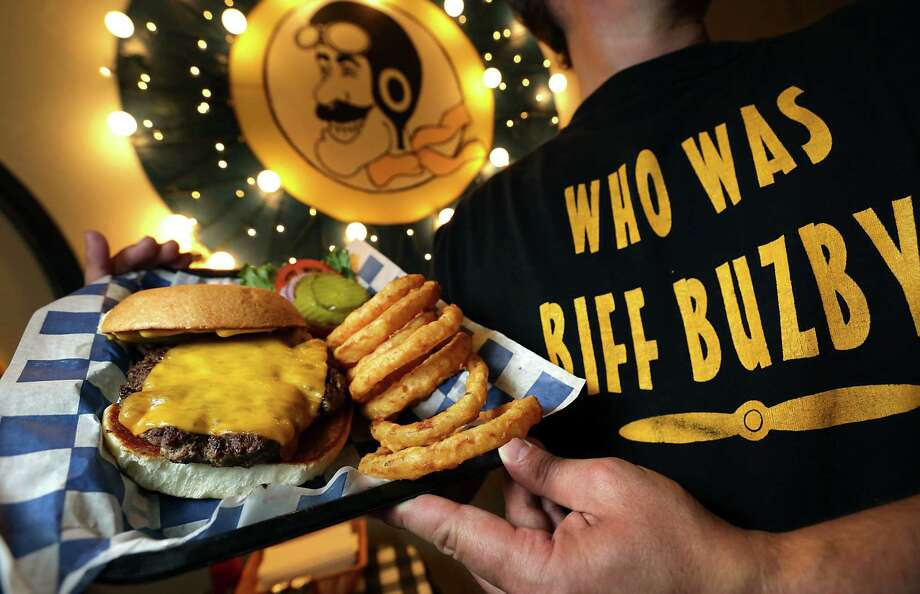 The Old Fashioned Hamburger comes with a quarter- or half-pound meat patty at Biff Buzby's. Onion rings round out the meal deliciously. Photo: Bob Owen / San Antonio Express-News