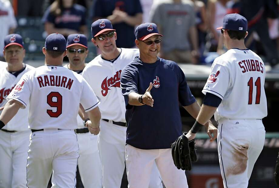 Cleveland manager Terry Francona greets Drew Stubbs after the Indians completed a four-game sweep of the A's. Cleveland out-homered Oakland 9-2 in the series. Photo: Mark Duncan, Associated Press