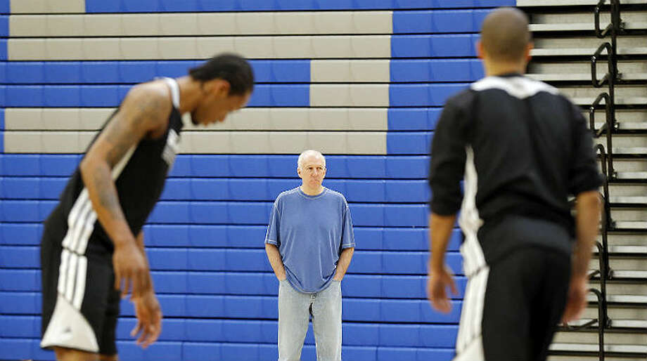 Spurs coach Gregg Popovich, overseeing practice earlier in the playoffs, got his first NBA coaching experience as a Spurs assistant under Larry Brown.  Edward A. Ornelas / San Antonio Express-News
