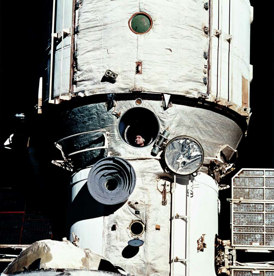 After the Soviet Union collapsed in 1991, the U.S. and Russia started cooperating more closely in space. In February 1995, space shuttle Discovery made a rendezvous with Mir, coming within 37 feet, but did not dock. Here, Cosmonaut Valery Polyakov appears at a window of Mir during the rendezvous. Photo: NASA, Getty Images / Archive Photos
