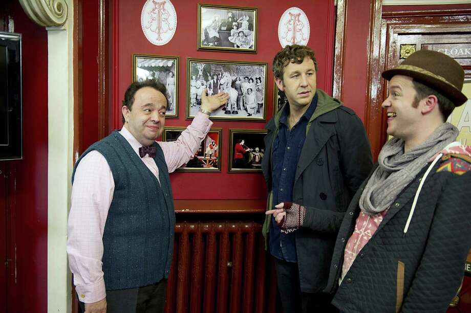 "Tom Chadwick (Chris O'Dowd, center) and his pal Pete (Tom Bennett, right) investigate an ancestor's stage career in ""Family Tree."" Photo: HBO"
