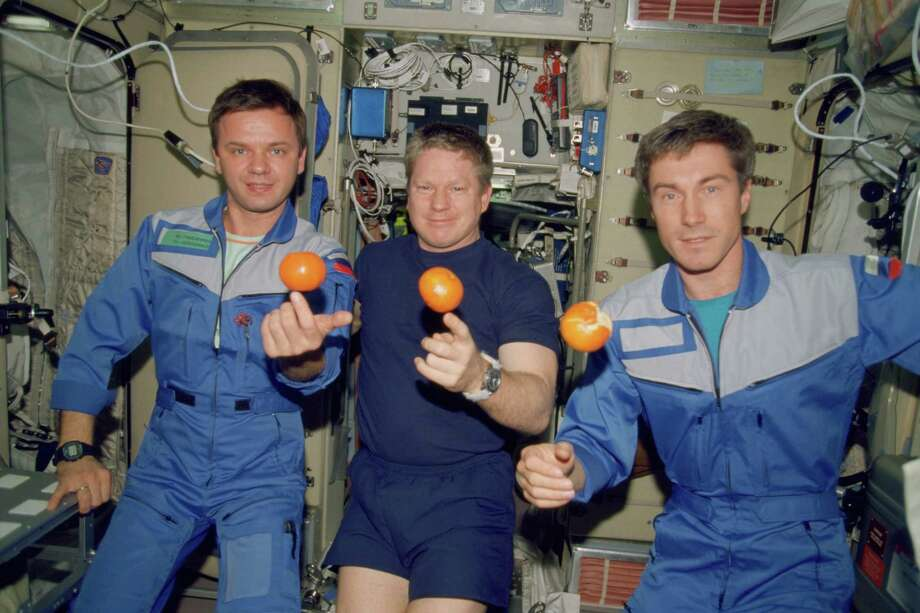 Astronaut Bill Shepherd, center, and cosmonauts Yuri Gidzenko, left, and Sergei Krikalev were the first crew to live on the International Space Station, launching aboard a Russian rocket on Oct. 31, 2000. Photo: NASA, Getty Images / Getty Images North America