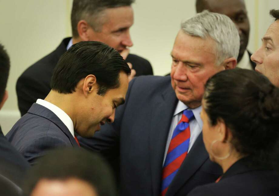 San Antonio Mayor Julian Castro, left, chats with Austin Mayor Lee Leffingwell, right, following President Barack Obama speech on Thursday May 9, 2013 at Applied Materials in Austin, TX. Photo: Bob Owen, San Antonio Express-News / ©2013 San Antonio Express-News