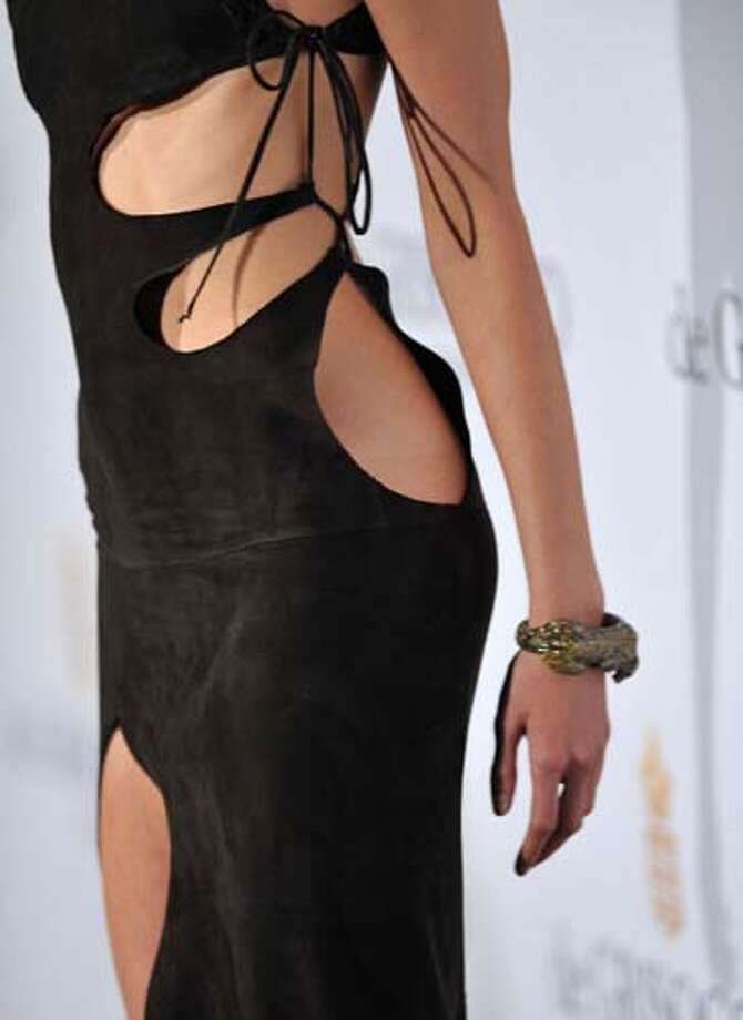 Model Karolina Kurkova shows that if you cut too much from a dress you can just tie it together with string. Photo: Pascal Le Segretain, Getty Images / 2011 Getty Images